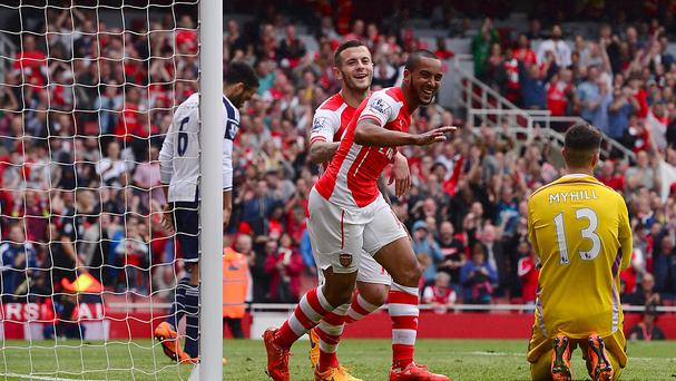 Theo Walcott, centre right, celebrates after scoring his third goal