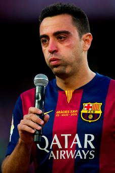 Xavi fought back tears as he thanked Barcelona fans for making him 'the happiest man in the world'