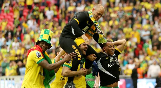 Alex Neil is carried on the shoulders of Norwich players at Wembley