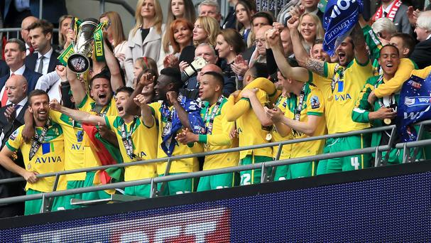 Russell Martin held the trophy aloft after Norwich claimed their play-off final win at Wembley