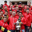 Arsene Wenger and his Arsenal players outside the Town Hall yesterday