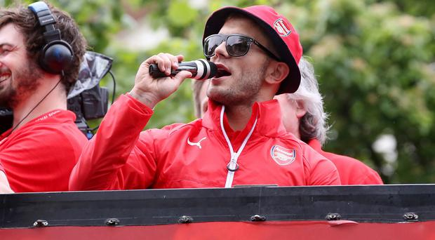 Jack Wilshere aimed a foul-mouthed outburst at Spurs during Arsenal's FA Cup victory parade