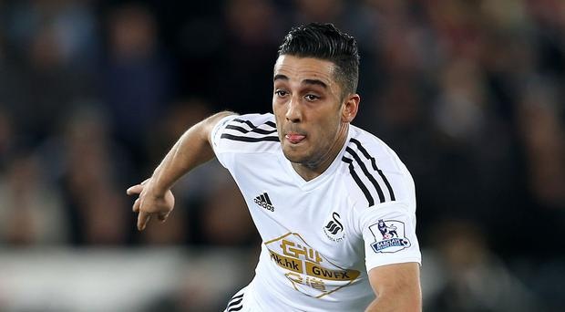 Swansea defender Neil Taylor has signed a new four-year contract