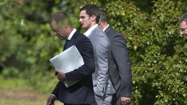 Adam Johnson, pictured centre, has denied three charges of sexual activity with a 15-year-old girl