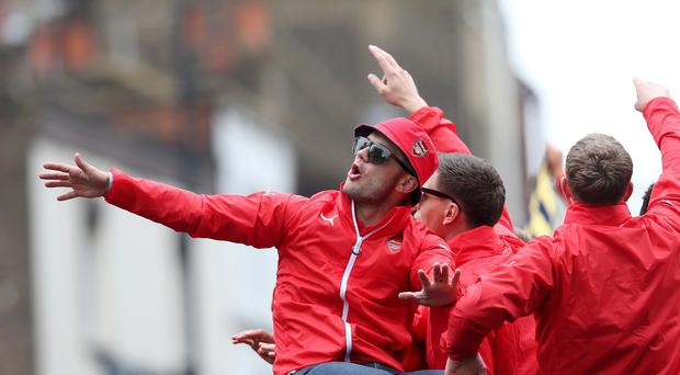 Arsenal midfielder Jack Wilshere has been charged by the Football Association for his outburst at the FA Cup trophy parade