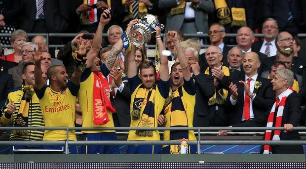 Aaron Ramsey, centre, believes the current Arsenal squad is good enough to challenge for the Barclays Premier League title