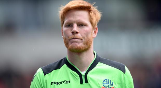 Bolton goalkeeper Adam Bogdan has become Liverpool's third signing of the summer