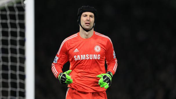 Bob Wilson believes signing Petr Cech, pictured, would bring Arsenal closer to the title