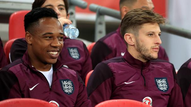 Liverpool midfielder Adam Lallana, centre, believes signing England team-mate Nathaniel Clyne, left, is a coup for the club