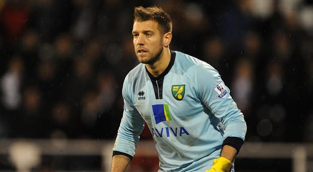 Aston Villa have signed former Norwich goalkeeper Mark Bunn on a two-year deal