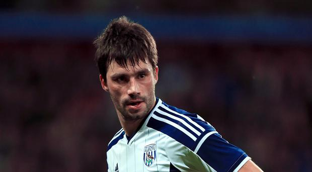 West Brom midfielder Claudio Yacob has signed a new two-year deal