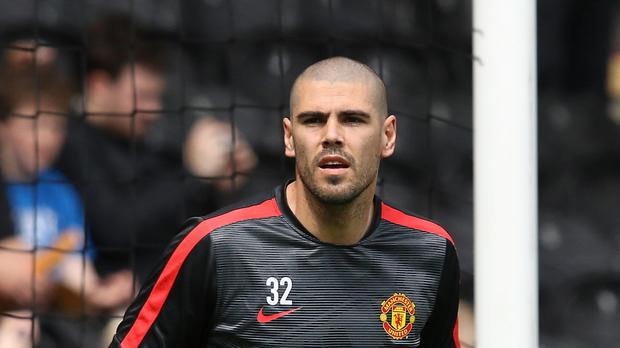 Victor Valdes is staying at Manchester United