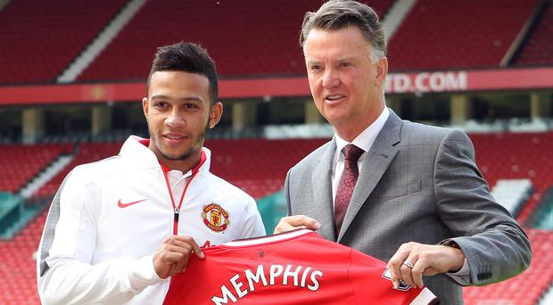 Louis van Gaal, right, signed Memphis Depay earlier this summer and could add more players