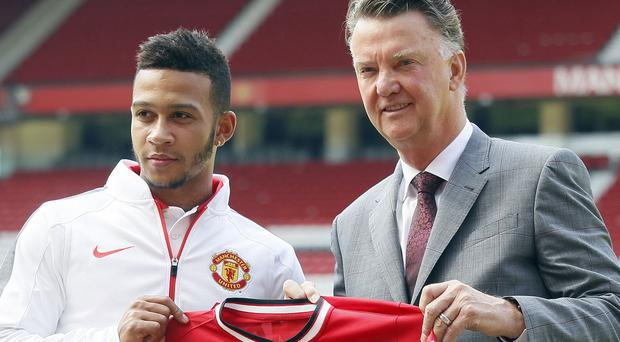 Memphis Depay, left, with Louis van Gaal at his unveiling at Old Trafford