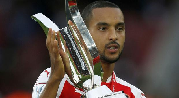 Arsene Wenger expects Theo Walcott, pictured, to sign a new deal at the club 'very soon'