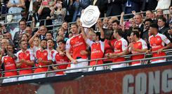 Per Mertesacker, centre, has backed Arsenal to mount a title challenge after their Community Shield triumph
