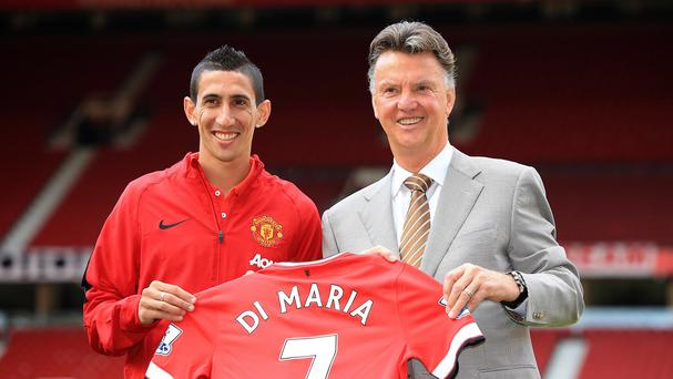 Angel di Maria (left) was all smiles when he joined United last summer