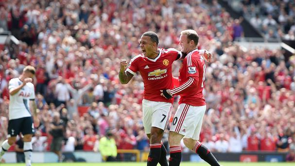 Manchester United's Wayne Rooney and Memphis Depay (centre) celebrate Tottenham Hotspur's Kyle Walker (not pictured) scoring an own goal during the Barclays Premier League match at Old Trafford, Manchester.