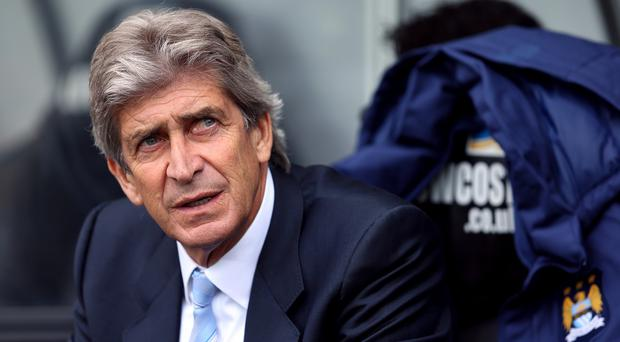 Manuel Pellegrini has signed a new two-year contract with Manchester City
