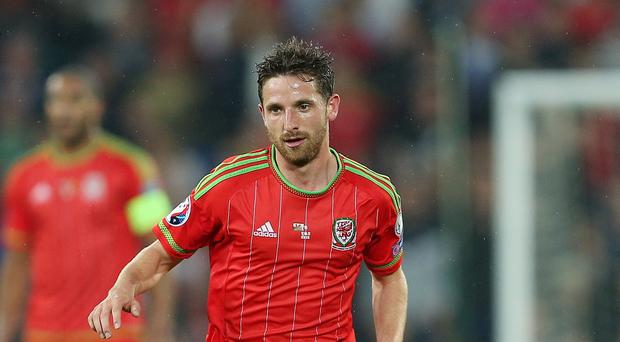 Liverpool and Wales' Joe Allen faces around a month on the sidelines