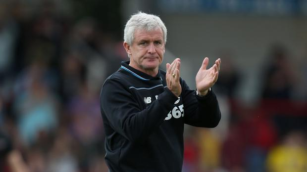 Mark Hughes has guided Stoke to back-to-back ninth-placed finishes
