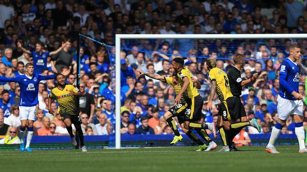 Watford celebrate Miguel Layun's opener on an encouraging afternoon at Everton