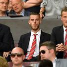 David de Gea, pictured centre, in the stands during United's win over Spurs at Old Trafford
