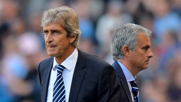 Manchester City manager Manuel Pellegrini, left, says he will shake hands with Chelsea rival Jose Mourinho