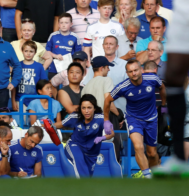 Eva Carneiro and head physio Jon Fearn leave the bench to treat Chelsea's Belgian midfielder Eden Hazard late in the game