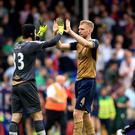 Defender Per Mertesacker, right, felt Arsenal worked hard for their victory at Crystal Palace on Sunday