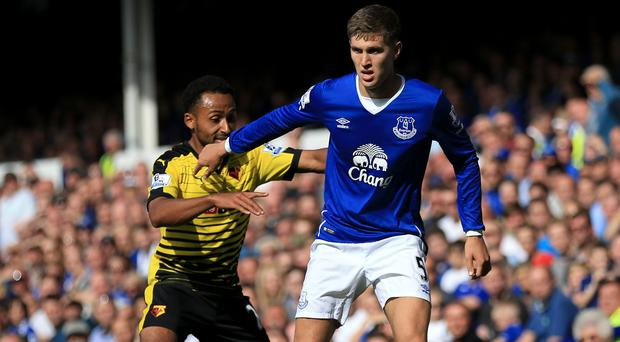 Everton remain determined to hold on to England defender John Stones, right