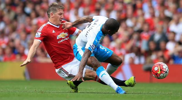 Manchester United's Bastian Schweinsteiger, left, and Newcastle United's Georginio Wijnaldum battle for the ball
