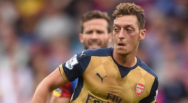 German playmaker Mesut Ozil has challenged Arsenal to rise to the challenge against Liverpool