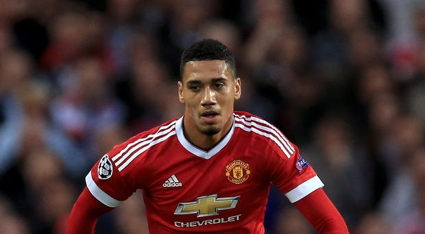 Chris Smalling has backed Wayne Rooney to rediscover his form