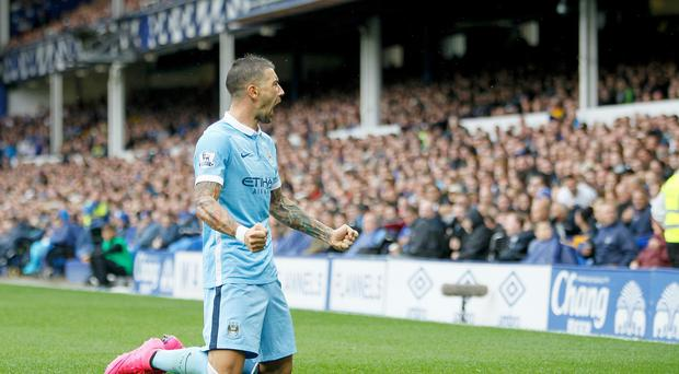 Aleksandar Kolarov scored the opener for Manchester City against Everton