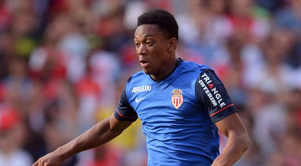 Anthony Martial has completed a move to Manchester United