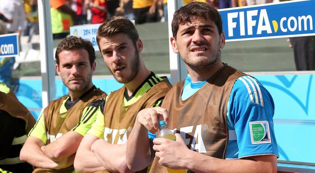 Juan Mata, pictured left, has backed David de Gea, centre, to react well to recent disappointments