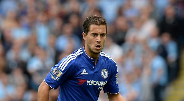 Chelsea's Eden Hazard says it is difficult being defending Premier League champions