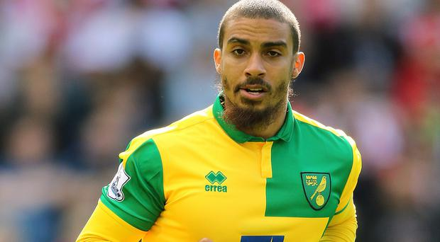 Norwich forward Lewis Grabban has returned from a club suspension for walking out of the team hotel