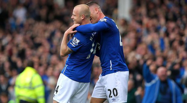 Steven Naismith, left, was the hat-trick hero for Everton