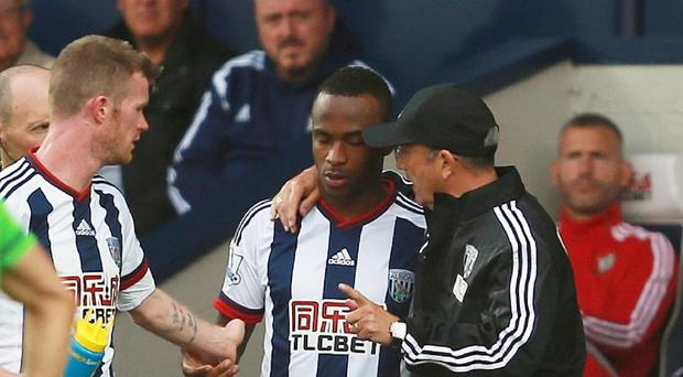 Saido Berahino speaks with manager Tony Pulis before coming off the bench