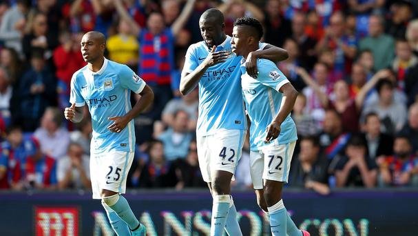 Kelechi Iheanacho, right, of Manchester City celebrates his winning goal