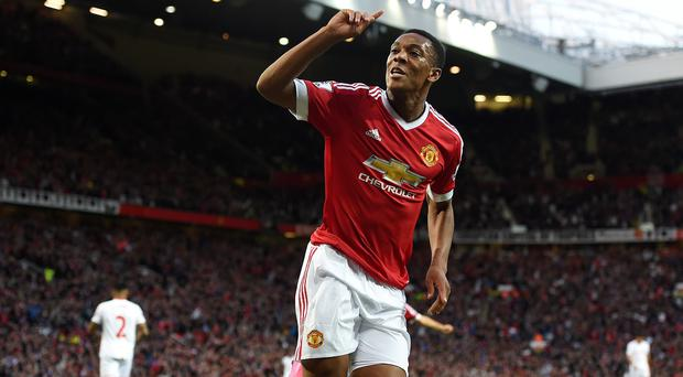 Anthony Martial celebrated his Manchester United debut goal in front of the Stretford End