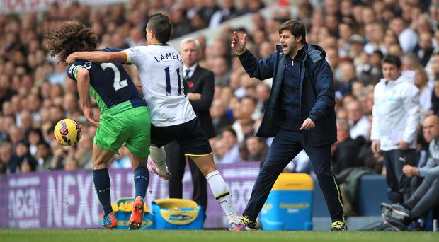 Mauricio Pochettino, pictured right, is hoping to develop Erik Lamela's game this term
