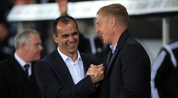 Roberto Martinez, pictured left, is a big fan of Swansea boss Garry Monk, right