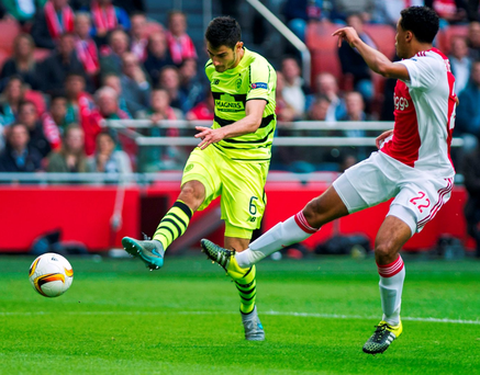 Celtic's Nir Bitton scores past Ajax defender Jairo Riedewald during the Europe League Group A clash