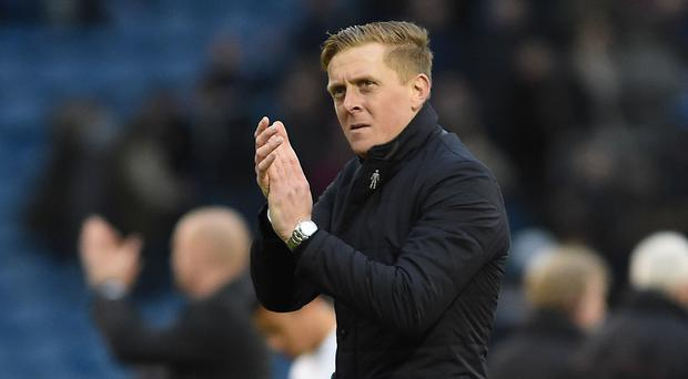 Swansea manager Garry Monk, pictured, has applauded Everton for the way they handled the John Stones transfer saga