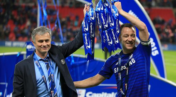 Jose Mourinho (left) and John Terry (right) after this year's League Cup triumph