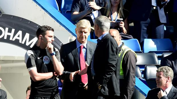 Chelsea manager Jose Mourinho (right) and Arsenal manager Arsene Wenger (centre)