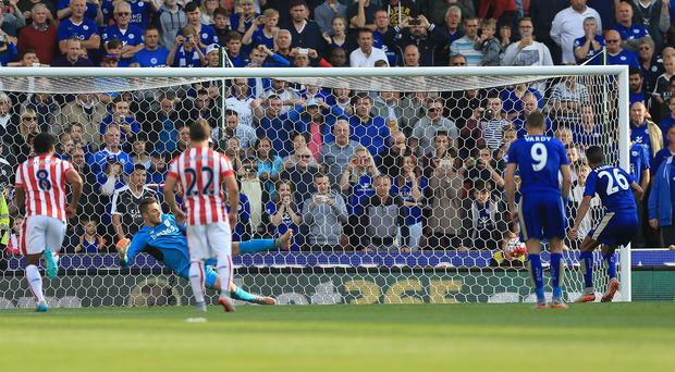 Riyad Mahrez, far right, slots home from the penalty spot